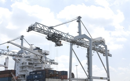 NETHERLANDS- JUNE 26: Crane in harbor of Rotterdam on June 26, 2012. Rotterdam is the largest port in Europe and the number three busiet port in the world only surpassed by Shanghai and Singapore.  A large extension of the port of Rotterdam (Maasvlakte 2)