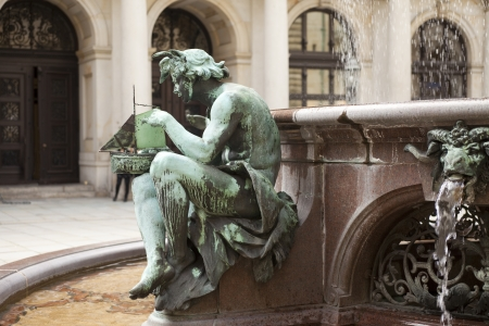 Detail of bronze statue on the fountain in the old city hall of Hamburg photo