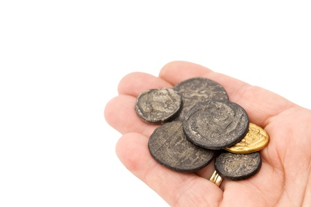 copper coin: hand with a collection of old roman coins Stock Photo