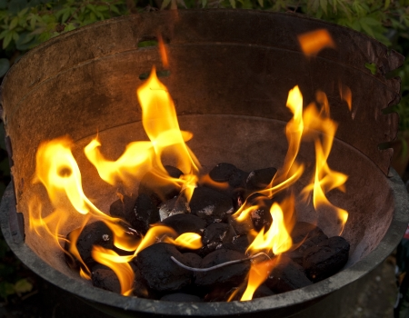 Barbecue with charcoal burning photo