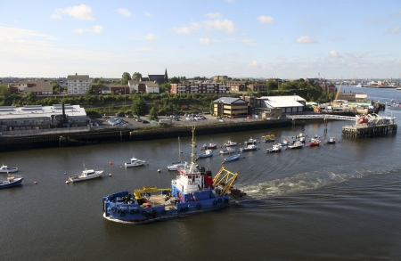 credited: NEWCASTLE, UK- AUG 11:Boats and ships at the Port of Tyne in Newcastle on Tyne on august 11, 2011.  Traditionally famous for its coal export it has changed radically and now belongs to the famous ports of the UK. Credited Port Operator of the Year in the