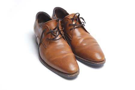 Brown leather mens shoes on white photo