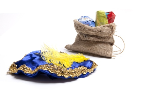 saint nicolaas: Hat of black Piet with bag filled with presents. Focus on bag Stock Photo