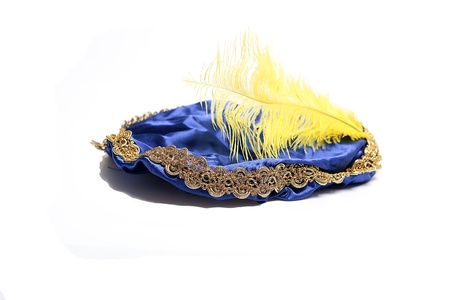 Blue hat with yellow feather of  the Dutch Black Piet  photo