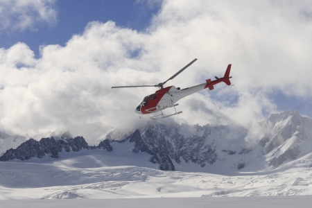 Helicopter flying over Franz joseph glacier in New Zealand photo