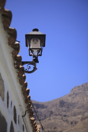 Solar lamp on roof of white house in Spain Stock Photo - 15730027