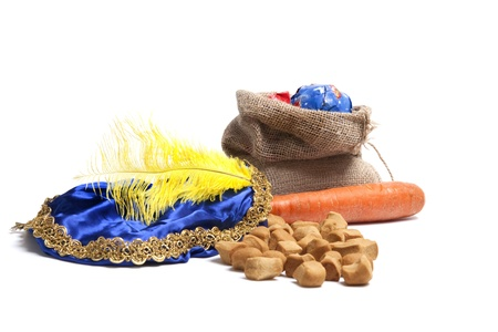 piet: Items concerning the Dutch holiday of Sinterklaas. Carrot for the horse, sweets, bag with presents and the hat of Zwarte Piet