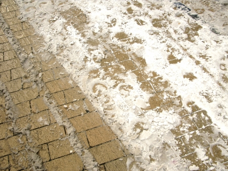 Pavement with melting snow photo