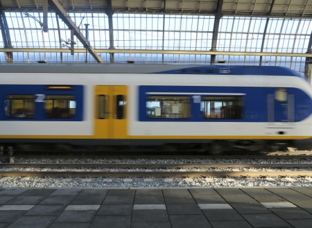 Train arriving at Amsterdam central station  photo