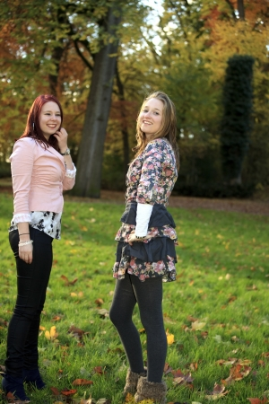 smiing: Two sisters posing in the park