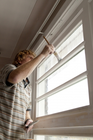 homeownership: Painter at work inside a home