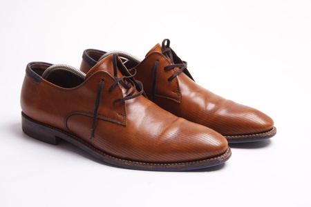 mens shoes:  Brown leather mens shoes with wooden shoe stretchers on the side