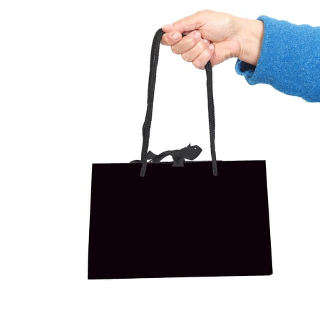 Hand in blue sweater holding black bag with black cord Stock Photo - 17365870