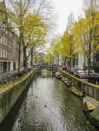 AMSTERDAM, NETHERLANDS-NOV 21: Canal in Amsterdam on Nov 21,2012. Amsterdam has been called the Venice of the North for its more than 100 KM kilometers of canals, about 90 islands and 1,500 bridges