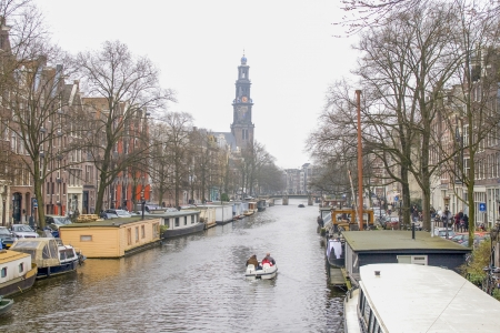 anne: AMSTERDAM, NETHERLANDS-FEB 23: Prinsengracht in Amsterdam with the Westerkerk on Feb 23, 2008. The biggest church in Amsterdam was built 1619 – 1631 and is regarded by many as the city symbol