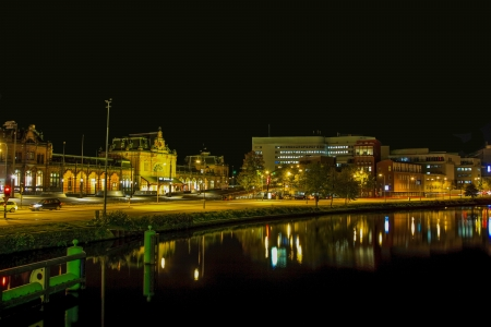 Cityscape of Groningen in the Netherlands at night with train station