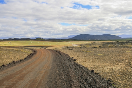View on a rugged landscape and a the main road in this part of Iceland Stock Photo - 17964474