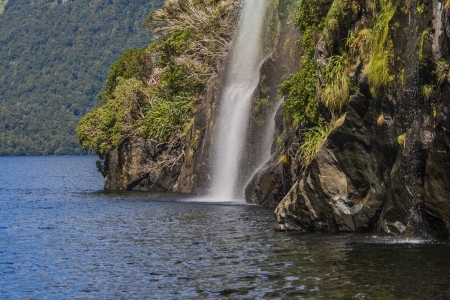 View on a waterfall in Doubtful Sound in New Zealand photo
