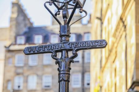 street name sign: Name Victoria Terrace on a cast iron lantern in  Edinburgh, Scotland Editorial