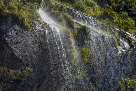 Sunlight on waterfall in New Zealand photo