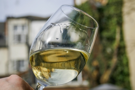 swirling: White wine swirling in a crystal glass outdoors