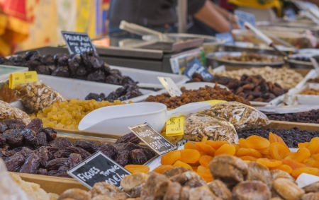 Market stall in France with dried fruits photo