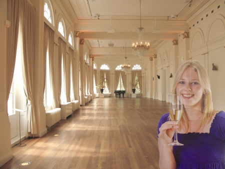 grand palace: Woman with champagne in a ballroom in sunlight with grand piano