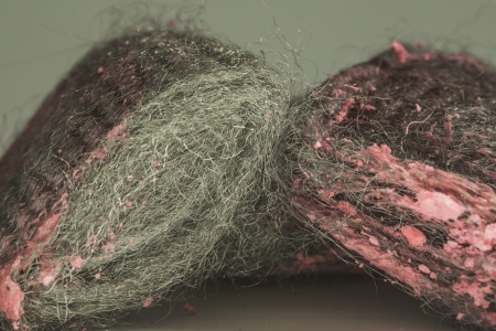 scrubbers: Close up of steel wool with pink soap pads Stock Photo