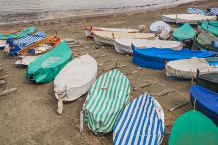 fishingboats: Small fishingboats under colored covers on an Italian beach
