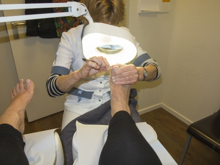 look after: GRONINGEN, NETHERLANDS-APRIL 24: Pedicurist treating foot of woman in salon. (Medical) pedicure is important for elderly. After 75, fewer than 30% of patients can still look after their feet themselves because they can't see well, they can't reach the