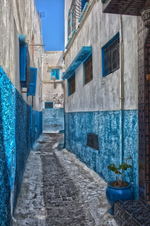 Blue and white colors in a street in the Medina in Rabat, Morocco photo