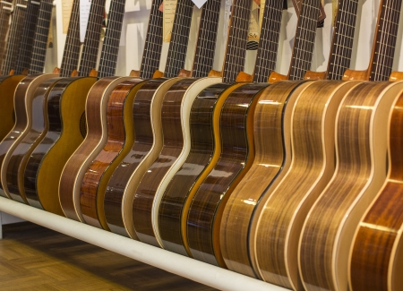 Row of acoustic guitars standing in a store   photo