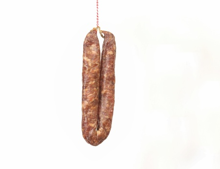 unreachable: Sausage on a string symbolising a Dutch proverb to lure someone with a sausage