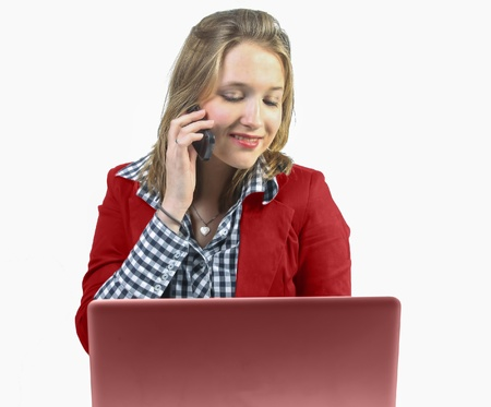 Young professional woman with phone behind laptop photo