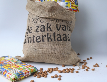 Dutch Sinterklaas celebration with a big bag filled with presents and gingernuts photo