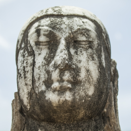 Close up of the head of a marble buddha photo