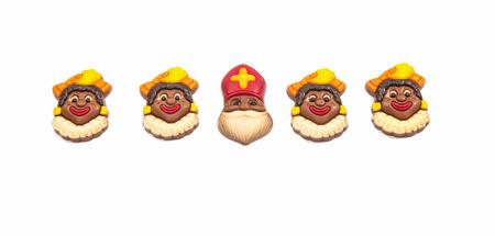 'black pete': Row of chocolate Dutch Sinterklaas with his Piets