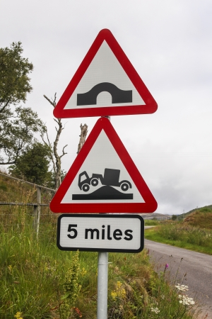 Bumpy road ahead sign on a Scottish rural road photo
