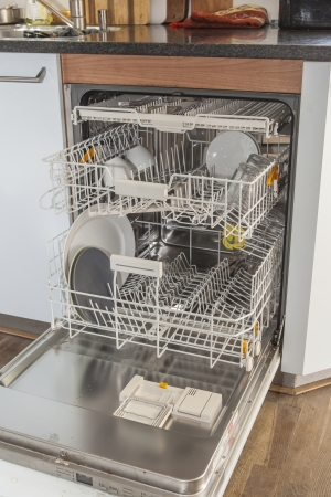 Open dishwasher with a few items in kitchen photo