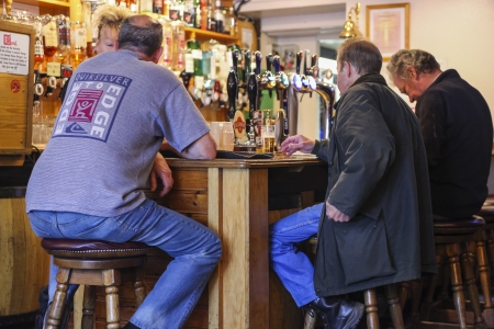 BALLATER, UK - JULY 22: Inside a local pub, for drinking and socializing, focal point of the community, on July 22, 2011. Pub business, about 53,500 pubs in UK, has been declining every year