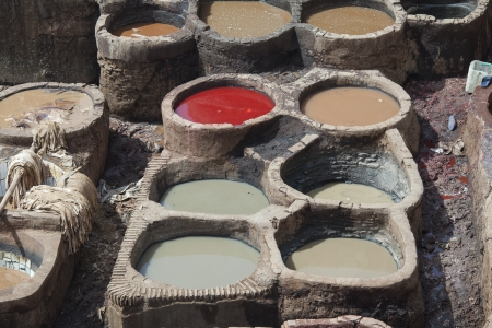 dyeing: Basins with natural color dye at the tannery in Fez, Morocco   Stock Photo