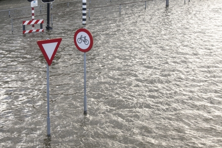 Ocean water flooding a coastal town in the Netherlands