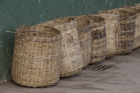 Wicker tea baskets on a tea plantation in Sri Lanka photo