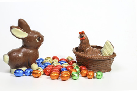 Chocolate easter bunny and chocolate chicken with easter eggs photo