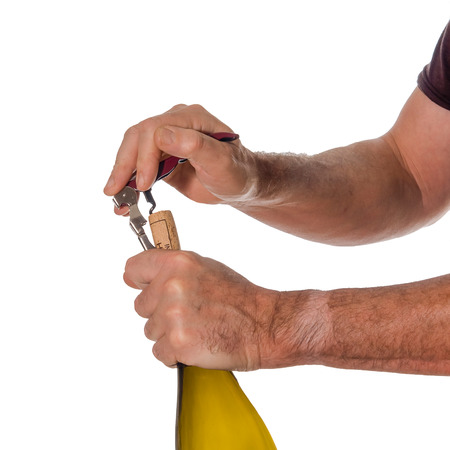 Opening a bottle of wine with a cork screw  photo