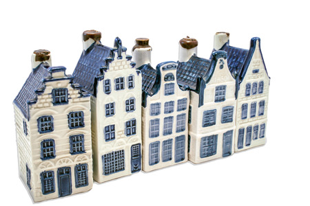 Five Delft blue house isolated on white photo