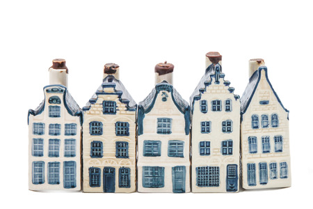 Row of five delft blue houses isolated on white photo