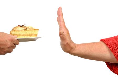 Hand sagt zu stoppen, um ein Stück Kuchen Standard-Bild - 25744177