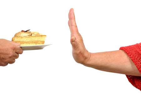 Hand says stop to a piece of cake