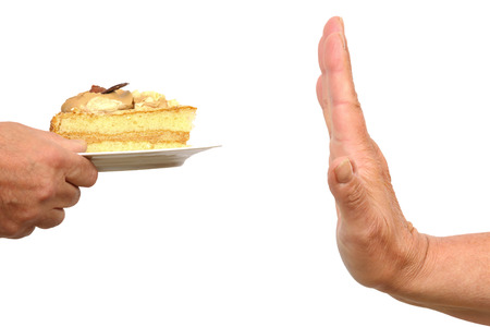 reject: Hand gesturing no to a piece of cake